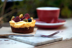 Cake and Coffee. Black coffee and a sweet fruit cheesecake served outdoors Stock Photo