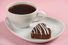Cake and coffee cup. On pink background royalty free stock photos