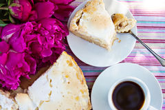 Cake and coffee. Piece of pie on a white plate, pie and a cup of coffe Stock Photos