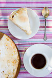 Cake and coffee. Piece of pie on a white plate, pie and a cup of coffe Stock Images