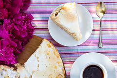 Cake and coffee. Piece of pie on a white plate, pie and a cup of coffe Royalty Free Stock Image