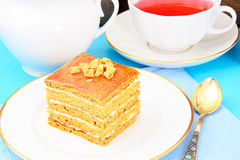Cake with Condensed Milk, Nuts and Honey. Tea. Tableware. Studio Photo royalty free stock photo