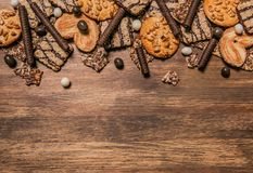 Cake confectionery glaze pastry sweet table wooden. Cookies with chocolate and sesame seeds on a wooden background with a texture Stock Photos