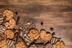 Cake confectionery glaze pastry sweet table wooden. Cookies with chocolate and sesame seeds on a wooden background with a texture dark Royalty Free Stock Photography