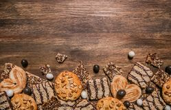 Cake confectionery glaze pastry sweet table wooden. Cookies with chocolate and sesame seeds on a wooden background with a texture frontal Royalty Free Stock Image