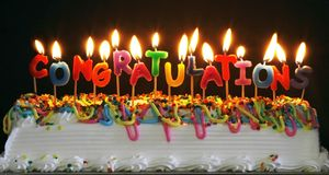Cake with congratulations candles Royalty Free Stock Photos