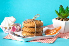 Cake and cookies on a bright background. Morning breakfast Royalty Free Stock Photo