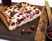 Cake of cottage cheese and red cherries , above Royalty Free Stock Photography