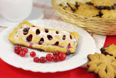 Cake with cranberries on decorated table Stock Photos