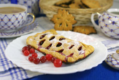 Cake with cranberries on decorated table Royalty Free Stock Photos