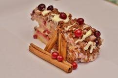 Cake with cranberries, white cream. And cinnamon sticks Stock Photo