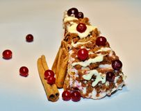 Cake with cranberries, white cream. And cinnamon sticks Royalty Free Stock Image