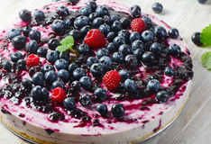 Cake with cream cheese and  berries Royalty Free Stock Images