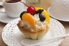 Cake with cream and cherries in a basket Stock Photo