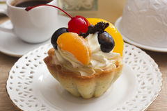Cake with cream and cherries in a basket Stock Image