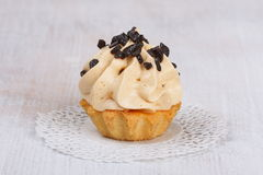 Cake with cream and chocolate topping Royalty Free Stock Photos