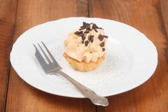 Cake with cream and chocolate topping Stock Image