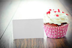 Cake with Cream, Cupcake on Woody Background Royalty Free Stock Photo