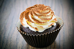 Cake with Cream, Cupcake on Woody Background Stock Photography