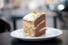 Cake with cream, food. Cake slice on white plate in paris, france, dessert. Temptation, appetite concept. Dessert, food, snack, pa. Cake with cream, food. Cake Stock Image