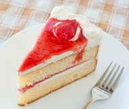 Cake with cream and jelly strawberries Stock Images