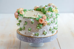 Cake with cream roses. Royalty Free Stock Images