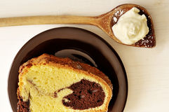 Cake and cream on spoon Stock Photography