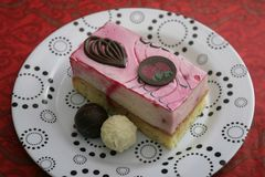 Cake with a cream of strawberries. Some cake with a cream of strawberries and chocolate Stock Images