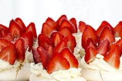 Cake with cream and strawberries Stock Photos
