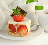 Cake from cream and a strawberry with mint Stock Image