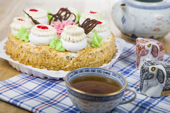 Cake with cream and tea. On the table Royalty Free Stock Photo