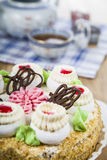 Cake with cream and tea. On the table Royalty Free Stock Images