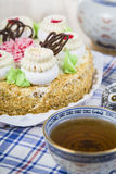 Cake with cream and tea. On the table Stock Image