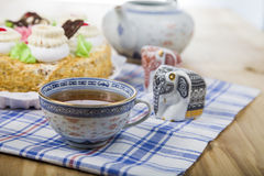 Cake with cream and tea. On the table Royalty Free Stock Photography