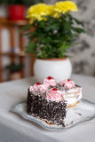 Cake with creamy flowers on  large plate Royalty Free Stock Image
