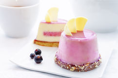 Cake with a creamy mousse and stuffed berry mousse Stock Image