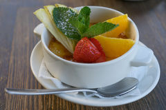 Cake creme brulee with fresh fruit. In a white dish Stock Photography