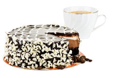 Cake and cup of cappuccino. Cake with cup of cappuccino in the background royalty free stock image