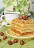 Cake and a cup of coffee. Honey cake with nuts and a cup of coffee Stock Images