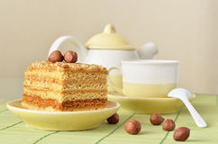 Cake and a cup of coffee. Honey cake with nuts and a cup of coffee for breakfast Royalty Free Stock Photography