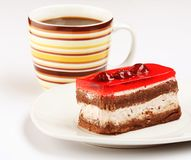 Cake with a cup of coffee Stock Images