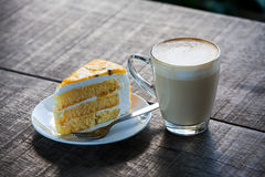 Cake with cup of coffee on old wood table Stock Images
