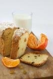 Cake cupcake raisins milk orange tangerine on a wooden surface Stock Image