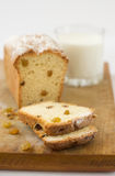 Cake cupcake raisins milk on a wooden surface. Delicious hot cake fruitcake muffin with raisins and milk wooden table Stock Image