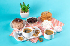 Cake, cups with coffee, cookies on a bright background. Morning breakfast Royalty Free Stock Photography
