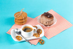 Cake, cups with coffee, cookies on a bright background. Morning breakfast Royalty Free Stock Image