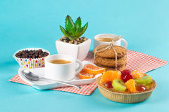 Cake, cups with coffee, cookies on a bright background. Morning breakfast Stock Photo