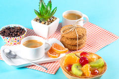 Cake, cups with coffee, cookies on a bright background. Morning breakfast Royalty Free Stock Images