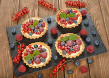 Cake with custard and berries Stock Photos