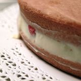 Cake with custard cream. And strawberries close up stock image
